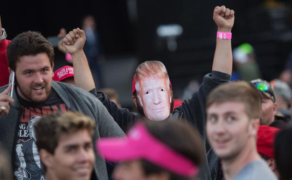 A supporter of Republican presidential candidate Donald Trump wears a mask during his Thursday campaign rally at the Orange County Fair and Event Center in Costa Mesa, California.