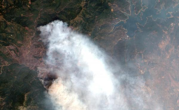 A satellite image provided by DigitalGlobe taken last week shows the Carr wildfire in Redding, Calif.
