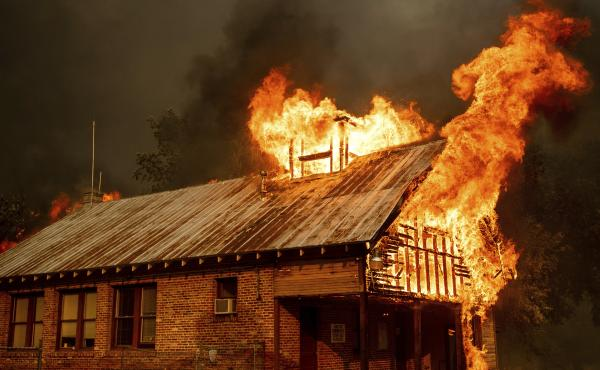 An historic schoolhouse burns as the Carr Fire tears through Shasta, Calif., on Thursday, fueled by high temperatures, wind and low humidity.