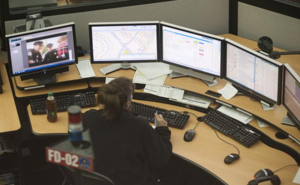 The Fairfax County 911 Center in Virginia takes calls during Hurricane Sandy in 2012. It was relatively easy to locate callers when most people used landlines. But most 911 calls now come from cellphones, which can pinpoint a callers' location only within