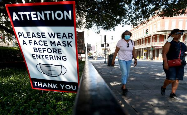 Scientists estimate that near-universal mask use could make a major difference in bringing down coronavirus infections in the United States.