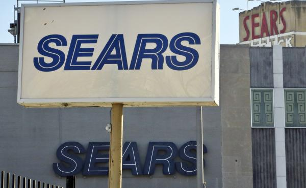 """Sears, once the monolith of American retail, says that there is """"substantial doubt"""" that it will be able to keep its doors open. Company shares tumbled more than 12 percent Wednesday. Above, the department store's location in Brooklyn's Flatbush neighborh"""