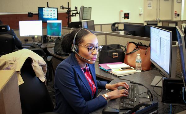 """Ogechi Ukachu, one of the registered nurses recently hired to help staff D.C.'s """"Right Care Right Now"""" program, takes a training call at the city's 911 call center."""