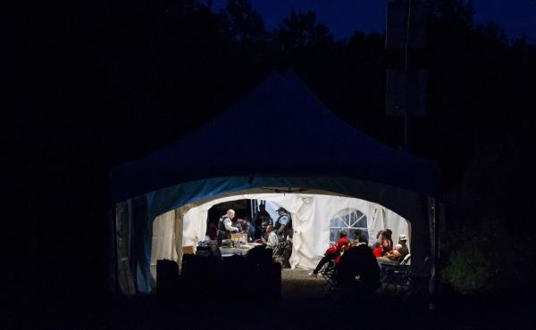 People who illegally crossed the Canada-U.S. border near Hemmingford, Quebec, are processed in a tent after being arrested by the Royal Canadian Mounted Police on Saturday. The flow of asylum-seekers has increased dramatically in recent weeks, and the wai