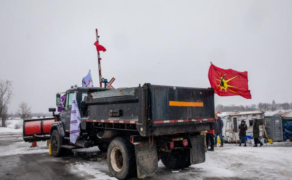 A truck sits parked at railway tracks during a protest near Belleville, Ontario, Canada, on Thursday. Demonstrators have been disrupting railroads and other infrastructure across Canada for more than a week to protest the planned Coastal GasLink pipeline.