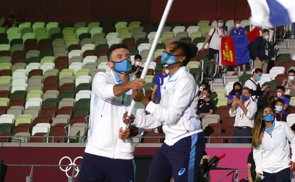 Uruguay flag bearers Deborah Rodriguez and Bruno Cetraro Berriolo lead their team out during the opening ceremony of the Tokyo 2020 Olympic Games at Olympic Stadium.