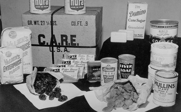 A typical CARE package: Among its comestible treasures are canned beef and liver loaf, powdered eggs and milk, coffee, sugar, flour, dried apricots, raisins — and chocolate.