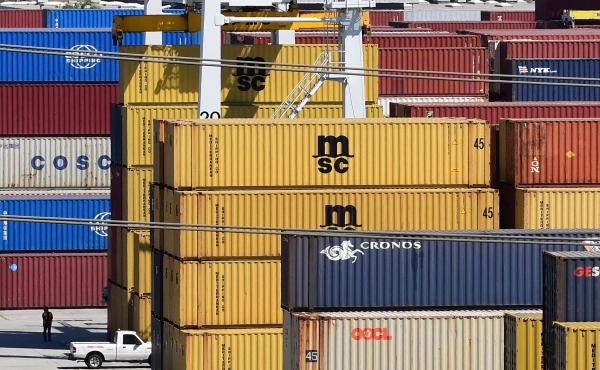 Shipping containers are stacked high at the Port of Los Angeles in April. Supply chain disruptions are hitting small-business owners across the United States.