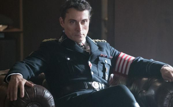 Brooding? Just a bit. Rufus Sewell stars as American Nazi leader John Smith in The Man in the High Castle.