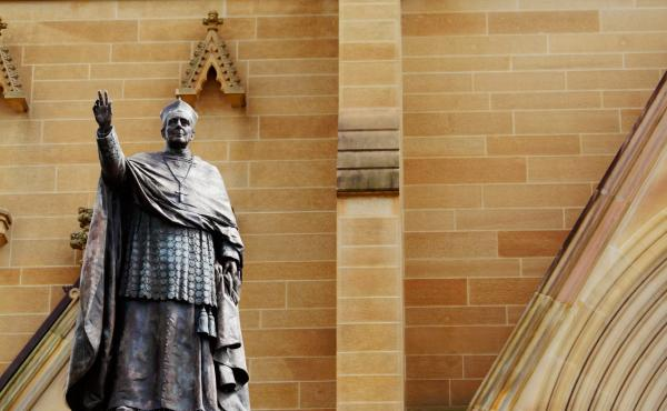 The bronze statue of Cardinal Moran stands by the entrance of St. Mary's Cathedral, in Sydney, Australia.