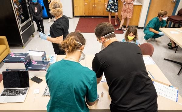 Nurses work at a COVID-19 testing day for students and school faculty at Brandeis Elementary School on in Louisville, Ky.