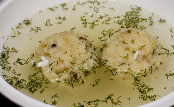 Matzo ball soup with dill. Matzo represents the unleavened bread the Jews ate while fleeing Egypt.