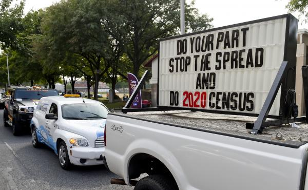 "A sign on the back of a truck promotes 2020 census participation in Reading, Pa. A day after the Census Bureau announced a new ""target date"" for ending counting efforts, a federal judge in California said she thinks the schedule is ""a violation"" of her co"