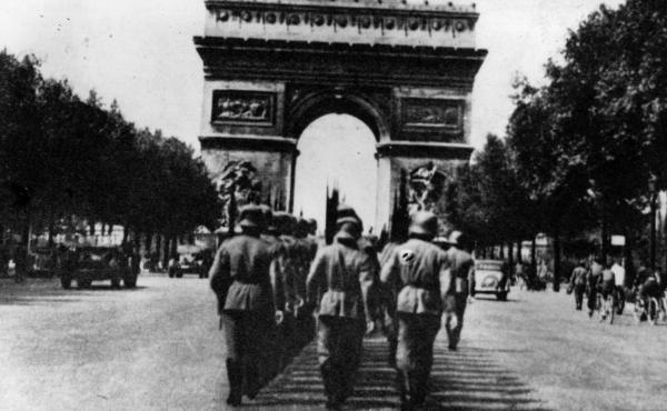 German troops march towards Paris' Arc de Triomphe in 1943.