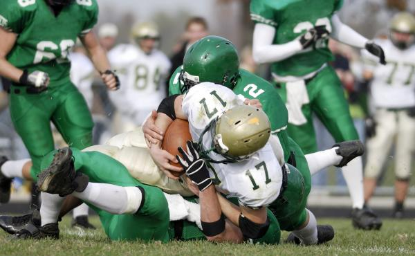 MRI scans before and after a season of football showed brain changes in a study of high school players.