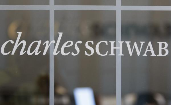 Brokerage giant Charles Schwab said Monday it will acquire competitor TD Ameritrade in an all-stock transaction valued at $26 billion. A Schwab office in Oakland, Calif., is seen here.