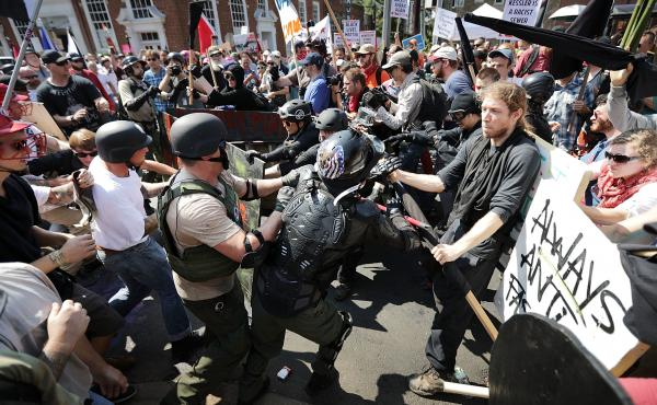 "White nationalists, neo-Nazis and members of the ""alt-right"" clash with counter-protesters in Charlottesville, Virginia during the ""Unite the Right"" rally August 12, 2017."