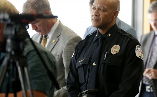 Charlottesville Police Chief Alfred Thomas listens earlier this month as an independent report on violence at a white supremacy rally is read at a news conference. Thomas announced his retirement Monday.