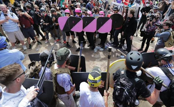 Following the weekend's violent clashes around a white nationalist demonstration in Charlottesville, Va., some are asking what authorities could have done differently. Above, demonstrators and counter-protestors face off at the entrance to Emancipation Pa