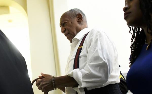 Bill Cosby is taken away in handcuffs after he was sentenced for felony sexual assault on Sept. 25, 2018, in Norristown, Penn.