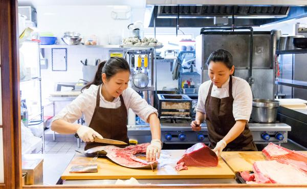 Chef Niki Nakayama in the kitchen with her wife and sous chef, Carole Iida-Nakayama. Nakayama is a modern master of the ancient Japanese art of kaiseki, a local, seasonal, multicourse meal rooted in Eastern philosophies that value being in harmony with na