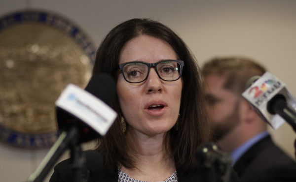 Dr. Anne Zink, Alaska's chief medical officer shown here at a press conference in March, has gotten praise from residents for her approach to dealing with the coronavirus outbreak.