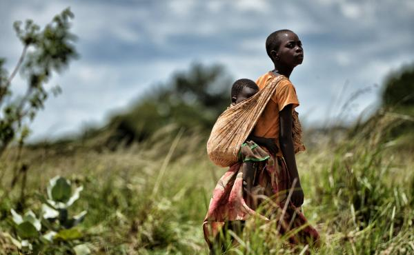 A girl carries a child in the outskirts of Lilongwe, the capital of Malawi. That's one of the countries in sub-Saharan Africa that has made good progress in reducing child mortality.