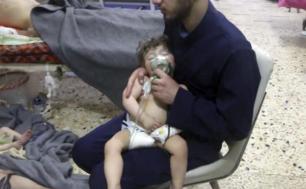 A medical worker gives a toddler oxygen through a respirator following an alleged poison gas attack in eastern Ghouta, Syria on April 8.