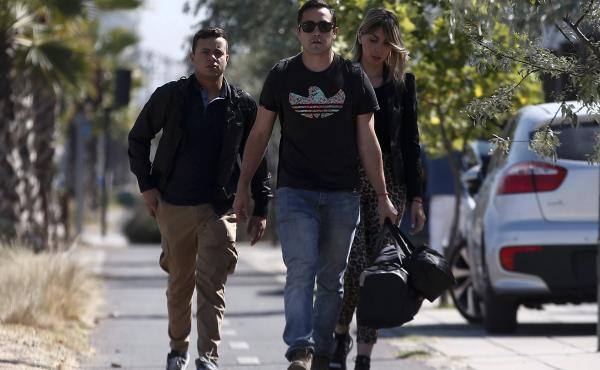Relatives of passengers of a missing military plane arrive at the Cerrillos air base in Santiago, Chile, on Tuesday.