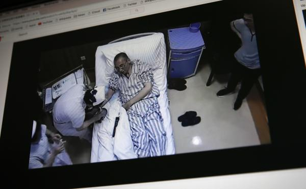 A video clip shows China's jailed Nobel Peace laureate Liu Xiaobo on a computer screen, lying on a bed receiving medical treatment at a hospital in Beijing. China says it has invited U.S. and German liver cancer experts to join a medical team treating Liu