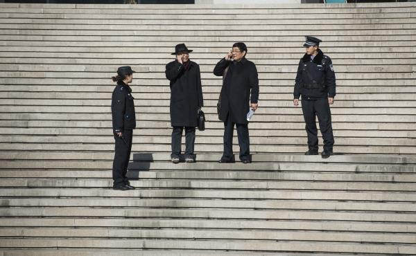Lawyers for the family of Nie Shubin, who was executed by firing squad in 1995 for rape and murder, leave court in December 2014. China's Supreme Court exonerated Nie on Dec. 2, following years of effort by his family to clear his name.