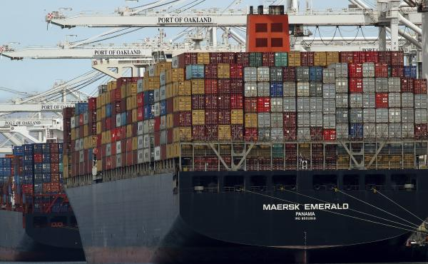 China's Ministry of Commerce is pursuing legal remedy against the U.S. over new tariffs on $200 billion worth of Chinese imports. Here, a container ship is unloaded at the Port of Oakland in California last week after completing a voyage from China.
