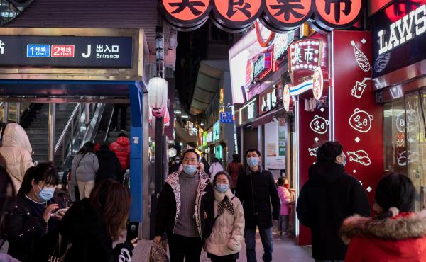 People walk in Wuhan on Jan. 10, the eve of the first anniversary of China confirming its first COVID-19 death. Chinese officials said on Monday that its economy managed to grow 2.3% in 2020.