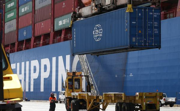 A shipping container is offloaded from the Hong Kong-based ship in Oakland, Calif., last month.