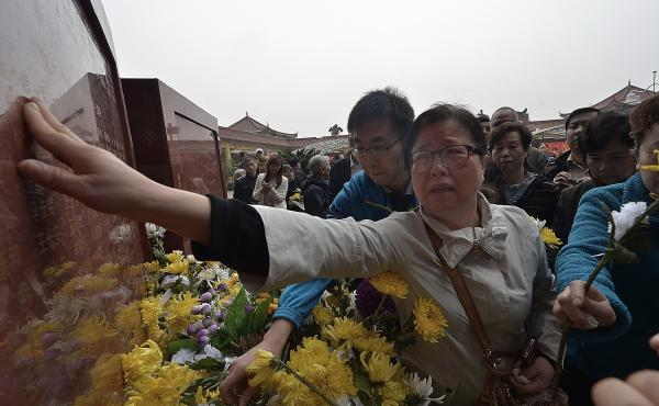 Relatives of deceased organ donors mourn for them at a ceremony unveiling a monument for the organ donors in April in Chongqing, China.
