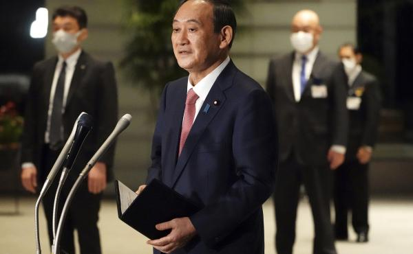 Japanese Prime Minister Yoshihide Suga speaks to media in Tokyo this month. Suga will take part in a Friday summit meeting with President Biden, the first foreign leader to meet the president face to face.