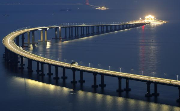 The Hong Kong-Zhuhai-Macau Bridge was lit up in Hong Kong on Monday, days before opening for public use. Called the world's longest cross-sea project, the bridge and tunnel extends for 34 miles.