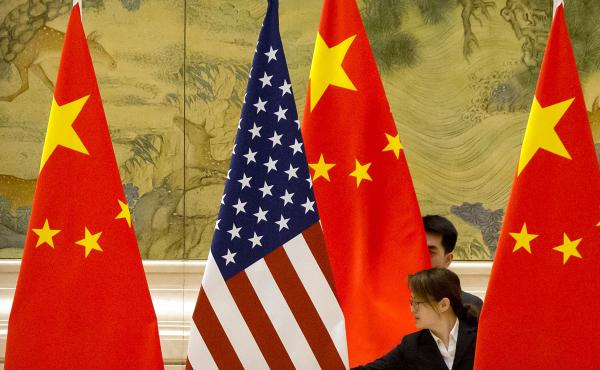 U.S. and Chinese flags before the opening session of 2019 trade negotiations between U.S. and Chinese trade representatives in Beijing. China just passed a sweeping law designed to counter sanctions the U.S. and the European Union have imposed on Chinese