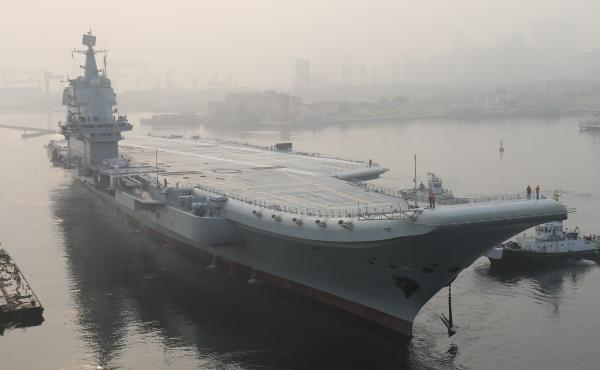 """China's first domestically manufactured aircraft carrier, known only as """"Type 001A"""", leaves port in the northeast city of Dalian in May. The vessel has reportedly begun sea trials ahead of its commissioning, expected next year."""