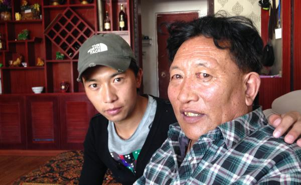 Zhaxi Cairang (right), a 59-year-old Tibetan nomad, moved to a city in western China 15 years ago as part of a government effort to settle nomads. But Zhaxi says he plans to return to herding yaks next year. His son Cicheng Randing was raised in the city,