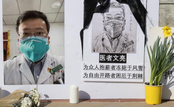 A memorial for whistleblower Li Wenliang sits on UCLA's campus in Southern California last month. Chinese authorities are now apologizing for the reprimand that the doctor received after warning of the coronavirus.
