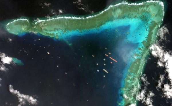 Overview of Whitsun Reef in the South China Sea and Chinese vessels moored in the waters surrounding the boomerang-shaped coral reef on March 23.