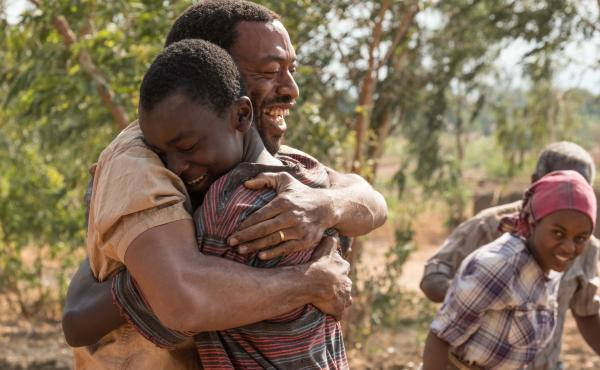 In The Boy Who Harnessed the Wind, Chiwetel Ejiofor (left) plays Trywell, the father of titular teenager William Kamkwamba (played by Maxwell Simba). Ejiofor also directed the movie and wrote the screenplay.
