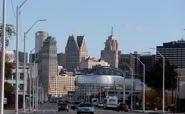 Detroit faces a $350 million deficit and is cutting city workers' pay.