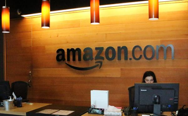 """Nikol Szymul staffs a reception desk at Amazon offices in downtown Seattle. Online retail powerhouse Amazon is searching for a second headquarters location, which an official from Toronto has called """"the Olympics of the corporate world."""""""