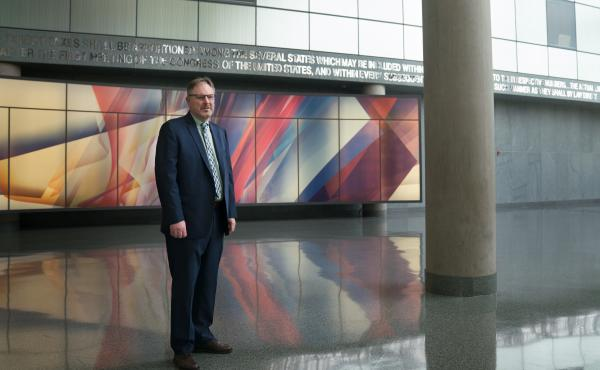 Acting U.S. Census Bureau Director Ron Jarmin stands in the lobby of the agency's headquarters in Suitland, Md. The bureau is facing six lawsuits from more than two dozen states and cities, plus other groups, that want a new question about U.S. citizenshi