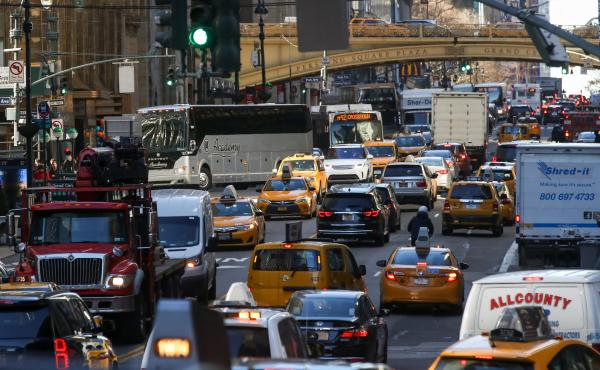 Traffic moves along 42nd Street in Midtown Manhattan on Jan. 25, 2018. After decades of efforts by transportation advocates, the state of New York has approved a plan to add congestion pricing to the city, charging drivers who enter a designated zone of M