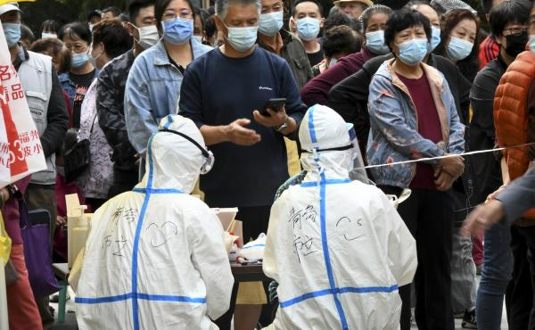 In this photo released by Xinhua News Agency, residents line up for coronavirus tests in Qingdao this week. China says it has carried out 10 million tests in the northern port city with no new cases found.
