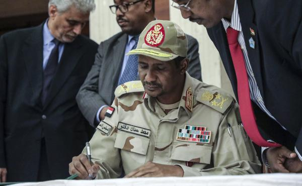 Gen. Mohammed Hamdan Dagalo signs a power sharing agreement with Sudan's pro-democracy movement and the ruling military council in Khartoum, Sudan.