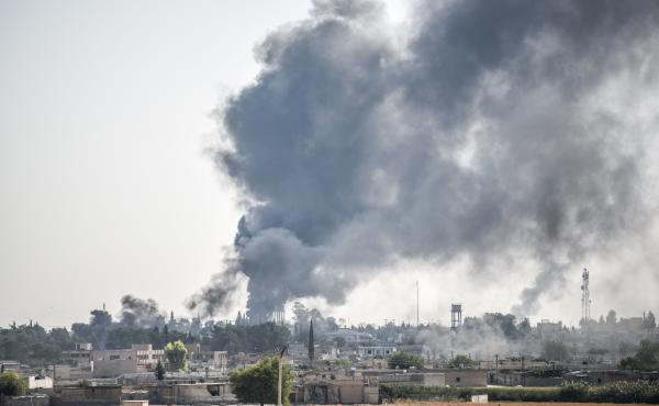 In this photo taken from the Turkish side of the border between Turkey and Syria, smoke billows from a fire inside Syria during bombardment by Turkish forces on Wednesday.
